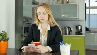 Businesswoman texting on smartphone and smiling to the camera, steadycam shot