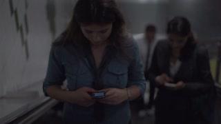Businesswomen riding on escalator, slow motion shot at 240fps, steadycam shot