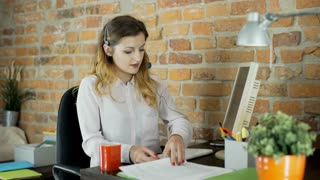 Call center agent talks with client and checks documents