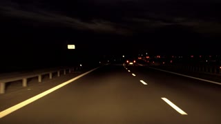 Cars riding on the motorway at night, steadycam shot