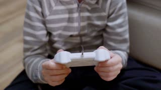 Child playing game and using joystick, steadycam shot