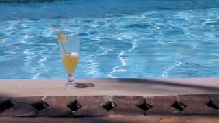 Cocktail standing at the edge of infinity swimming pool