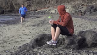 Couple after jogging, man drink water, slow motion shot at 120fps