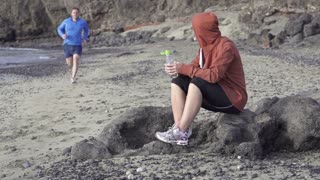 Couple after jogging, man drink water, slow motion shot at 240fps