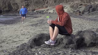 Couple after jogging, man drink water, slow motion shot at 60fps