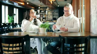 Couple drinking coffee and chatting in the restaurant