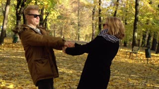 Couple having fun and smiling in the park, slow motion shot