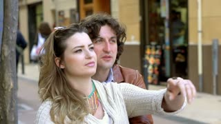 Couple holding each other in the city, steadycam shot, slow motion shot