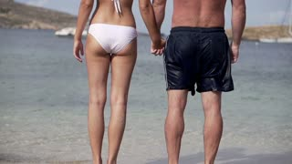 Couple in love standing on the beach, slow motion shot at 120fps