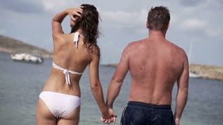 Couple in love standing on the beach, slow motion shot at 240fps