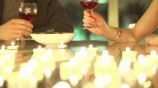 couple making a toast with glasses of wine during a romantic evening