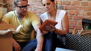 couple planning to decorate their new flat on a tablet