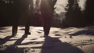 Couple running to the forest on snow, steadycam shot, slow motion shot