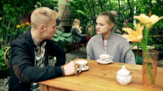 Couple sitting in the cafe and chatting together