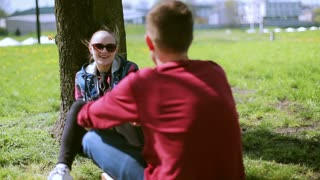 Couple sitting in the park and flirting with each other