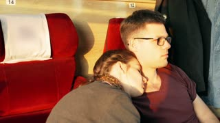 Couple traveling and sleeping in the train, steadycam shot