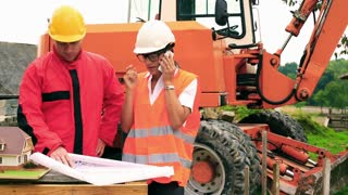 Engineer consulting project on the phone on the construction site