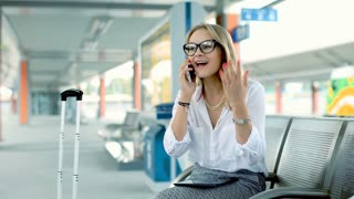 Excited businesswoman talking on cellphone and having good news