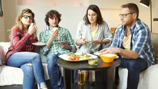 Friends eating lunch together and woman getting dirty