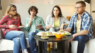 Friends eating lunch together and woman looking full