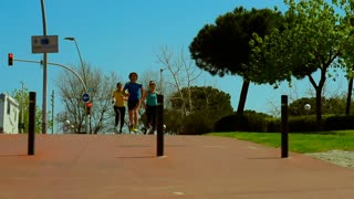 Friends start running in the city, steadycam shot, slow motion shot