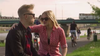 Girl comforting her boyfriend after quarrel