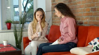 Girl crying because of problems and her friend comforts her
