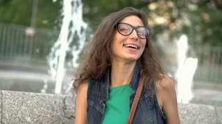 Girl laughing while pointing at something, steadycam shot, slow motion shot at 2