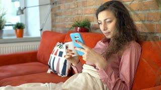 Girl looking happy after receiving message and texting back