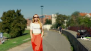 Girl walking on pathway and doing serious look to the camera