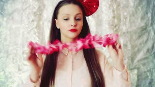 Girl wearing red bow and dancing to the camera, steadycam shot
