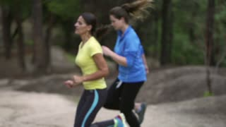 Girlfriends jogging in the park, slow motion shot at 240fps, steadycam shot