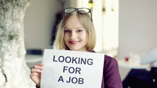 Happy businesswoman looking for the job, steadycam shot