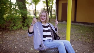Happy girl swinging on the seesaw in the park