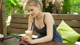 Happy girl texting on smartphone and looking very happy