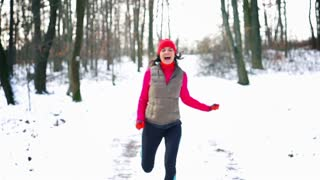 Happy jogger running and jumping to camera, steady, slow motion shot at 240fps