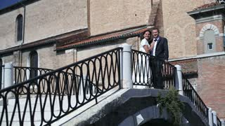 Happy just married couple on the bridge in Venice
