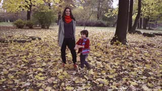 Happy mother walking with son, steadycam shot, slow motion shot at 240fps