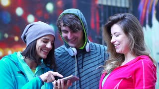 Happy, sporty people looking on smartphone, steadycam shot, slow motion shot at