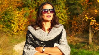 Happy woman having a walk in the autumnal scenery, steadycam shot