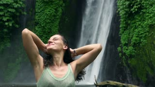 Happy woman touching hair and feeling free, slow motion shot at 240fps