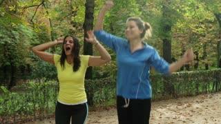 Happy women jumping because of winning contest, steadycam shot