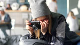 Hpster girl doing photo of pizza on old camera, steadycam shot