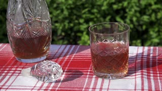 ice cubes throwing into the glass of whisky, slow motion shot at 240fps