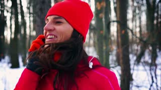 Jogger jumping in forest and talking on cellphone, steady, slow motion shot