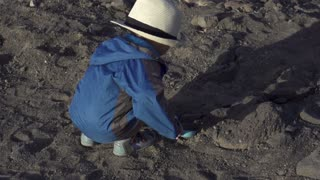 Little boy playing on the beach, slow motion shot at 240fps