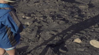 Little boy playing on the beach, slow motion shot at 60fps