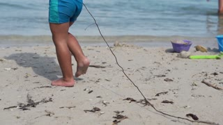 Little boy walking on the beach, slow motion shot at 240fps
