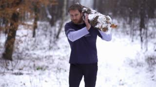 Lumberjack strong man carrying downed log
