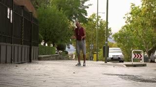 Man cheering on jogging women, slow motion shot, steadycam shot